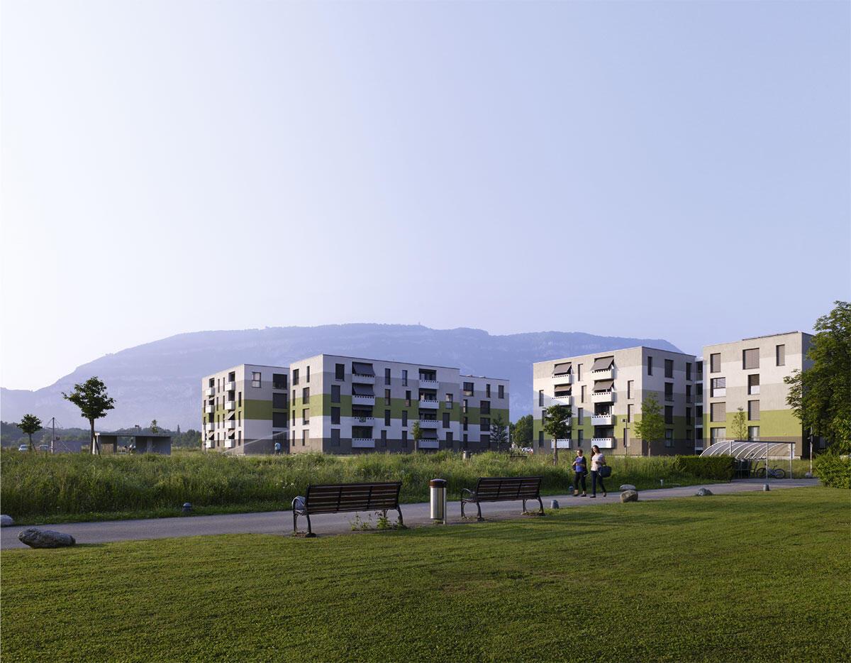 Das Plateau de Vessy mit Blick über die Arve zum Salève. Als Vorposten städtischer Dichte drängen sich die drei Gebäudegruppen dicht aneinander und konzentrieren so das soziale Leben der Siedlung.