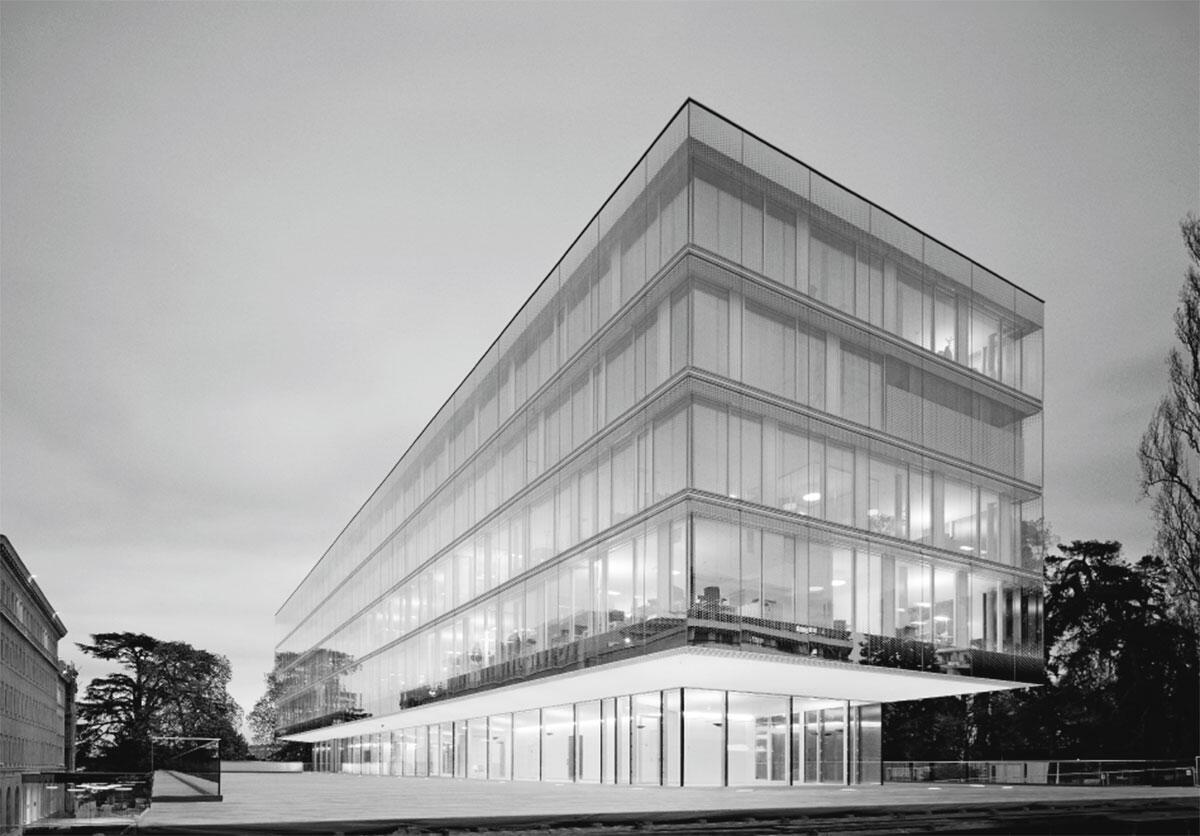 Transparenz nach innen und aussen charakterisiert das Gebäude der Welthandelsorganisation WTO in Genf. Ansicht von Westen.