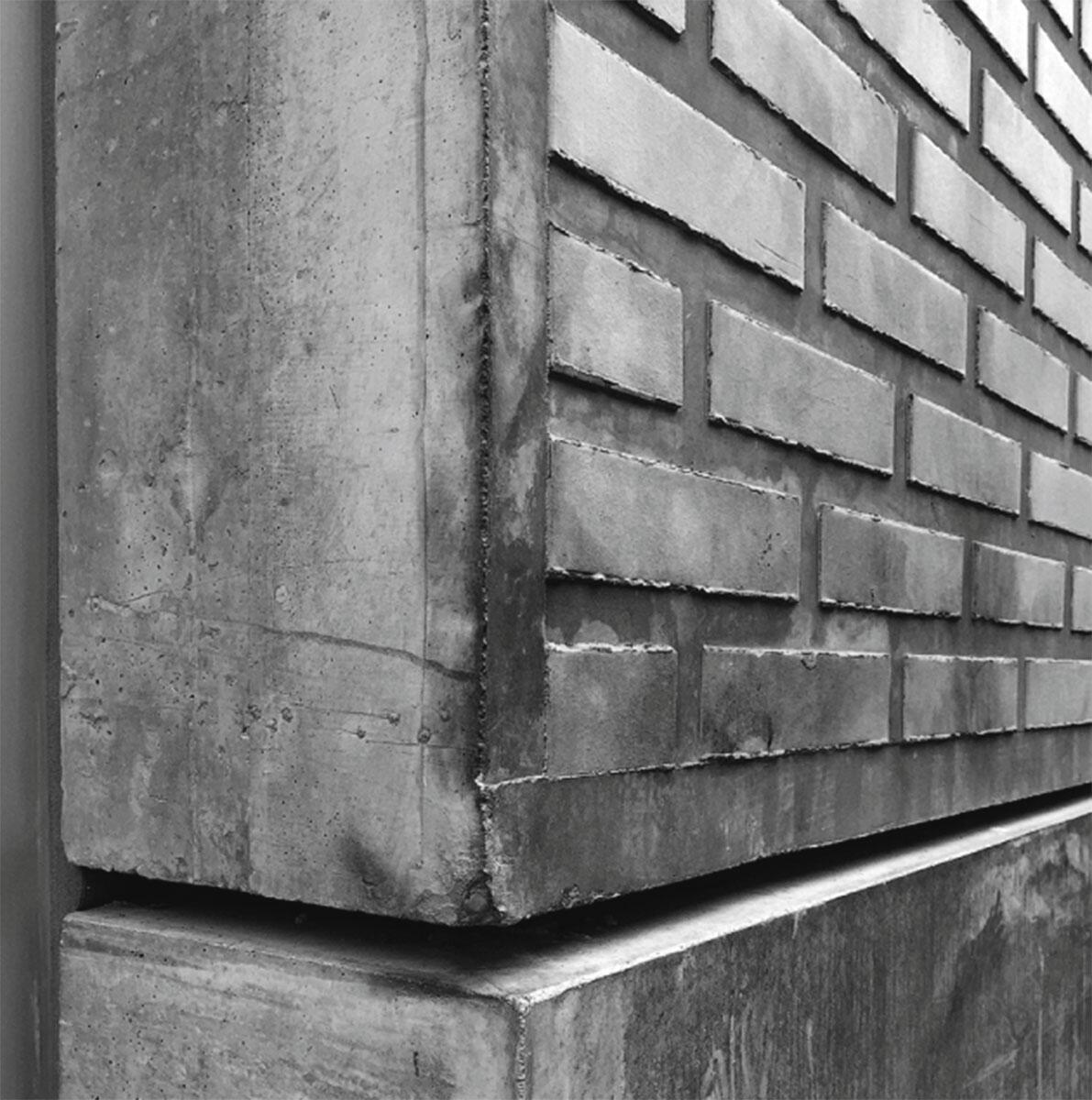 Geschnittene Steine in einer Zement-Matrix: Fassadenelement der Überbauung Hohlstrasse in Zürich von Adrian Streich und Loeliger Strub Architekten.