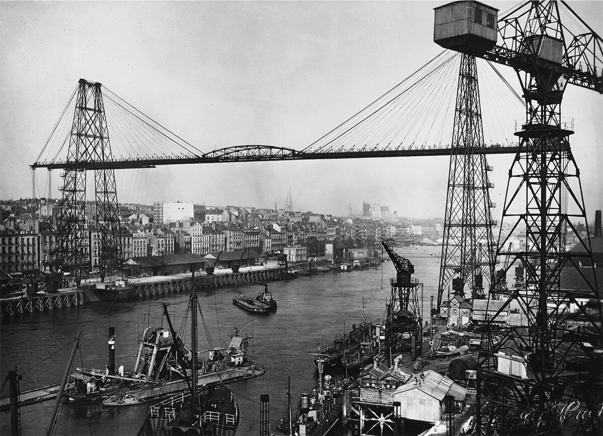 Hafengebiet an einem Flussarm der Loire; die Brücke wurde 1903 erstellt und 1958 wieder abgebrochen.