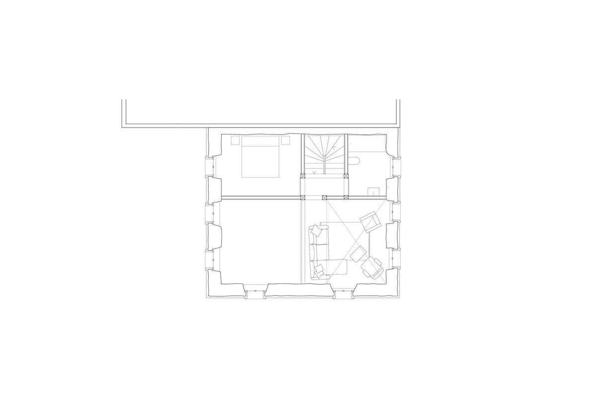 In direktem Blickkontakt mit dem Wohnen über dem Luftraum über dem Essbereich findet sich eine Sitzgruppe.